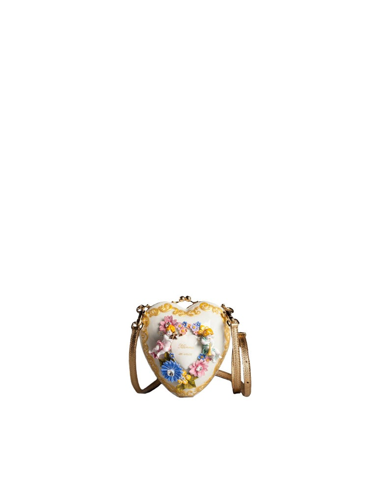 Gorgeous brand new with tags, 100% Authentic Dolce & Gabbana BOX bag purse. Model: Sacred Heart Cuore Style: Hand shoulder clutch Material: 10% Aluminum, 10% Crystal, Porslin, Crystal, leather Color: White with multicolor hand painted floral, gold