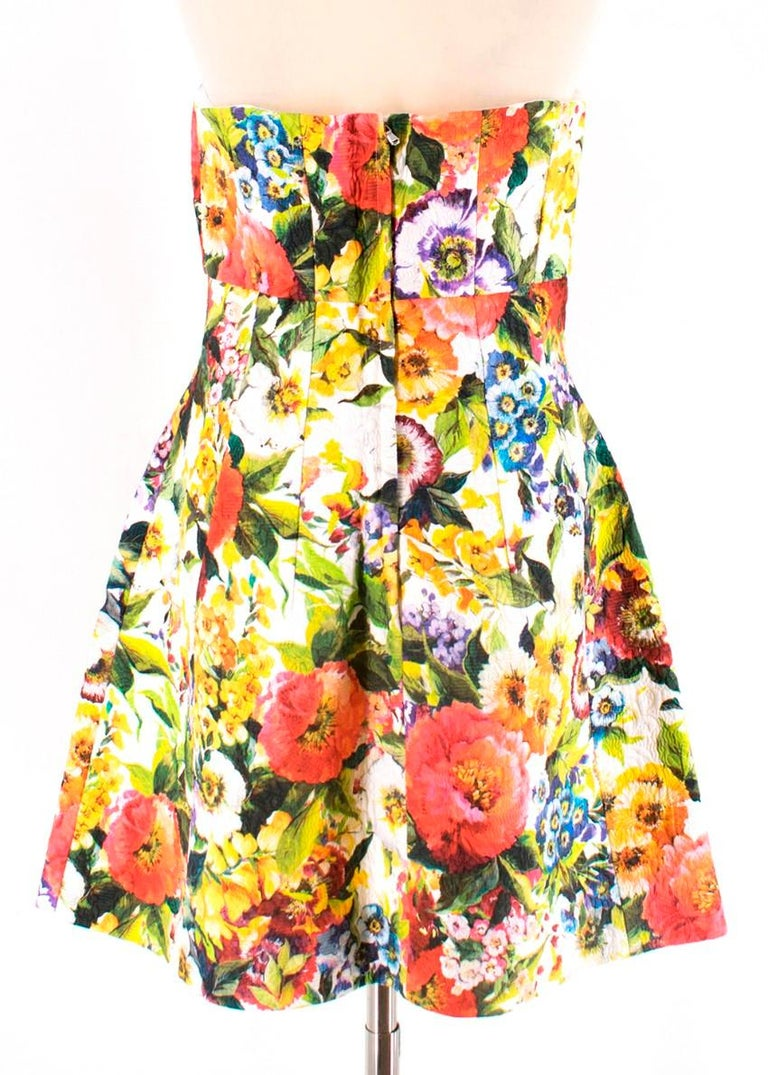 Dolce & Gabbana's colourful floral-brocade dress.The cut creates a feminine silhouette and it's designed with an internal corset for support at the bust.Designed to be fitted at the bust and waist, slightly loose at the hip. True to size. Internal