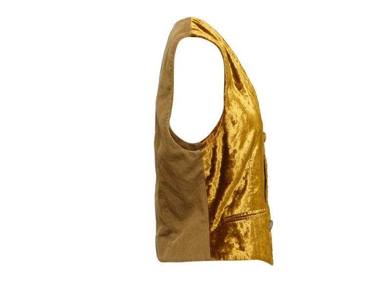 Product details: Vintage gold velvet vest by Dolce & Gabbana. V-neckline. Three welt pockets. Contrast fabric panel at back. Button closures at center front. Designer size IT38. 38