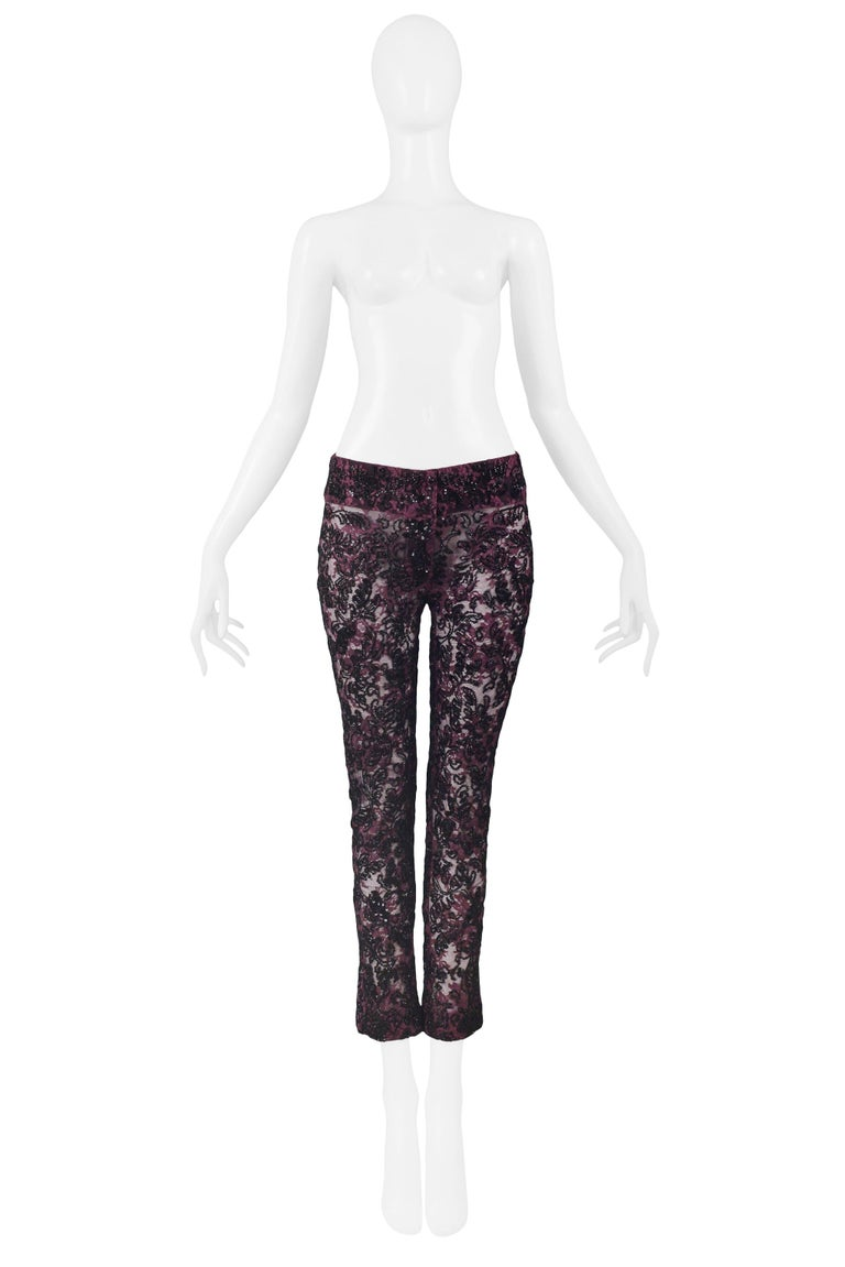 Resurrection Vintage is excited to offer a vintage pair of Dolce & Gabbana heavily beaded pants. The pants are made of fine cotton and spandex and feature a front zipper, two snap button closure, and black floral beading.   Dolce & Gabbana Size