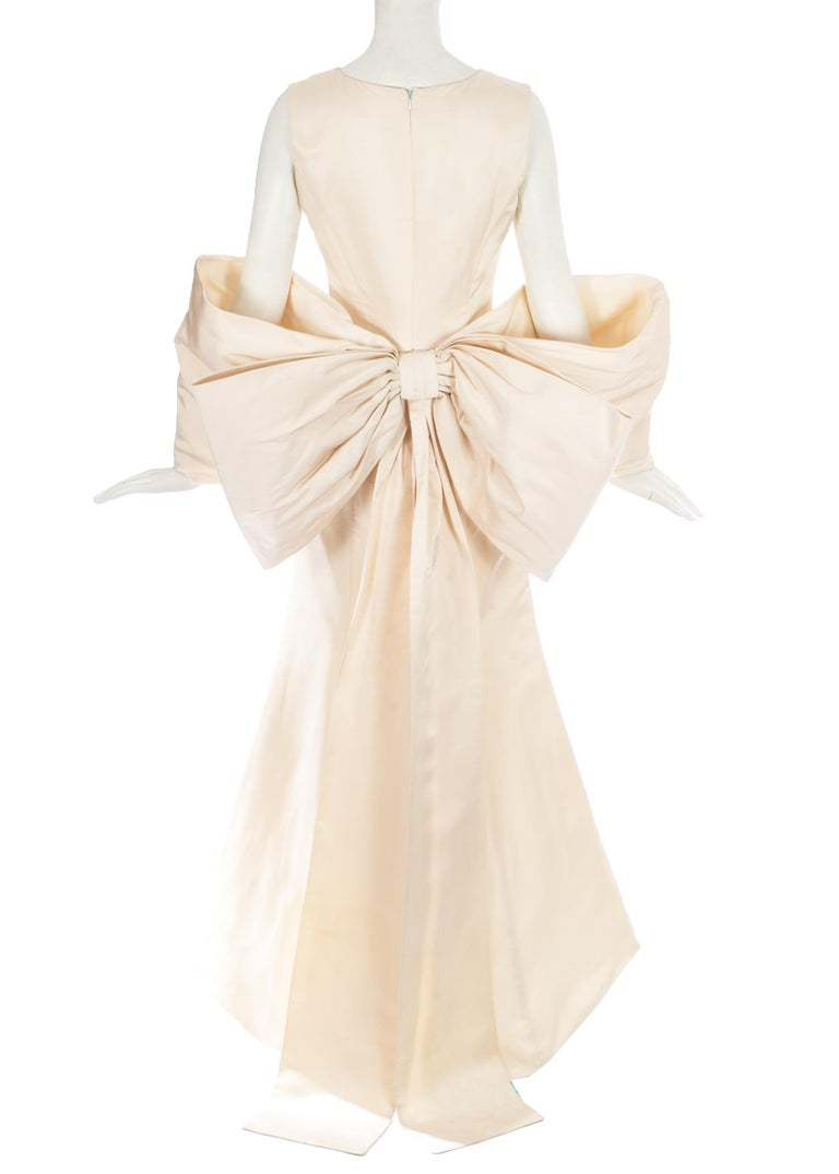 Dolce & Gabbana ivory silk fishtail wedding dress with large bow at rear  c. 1990s