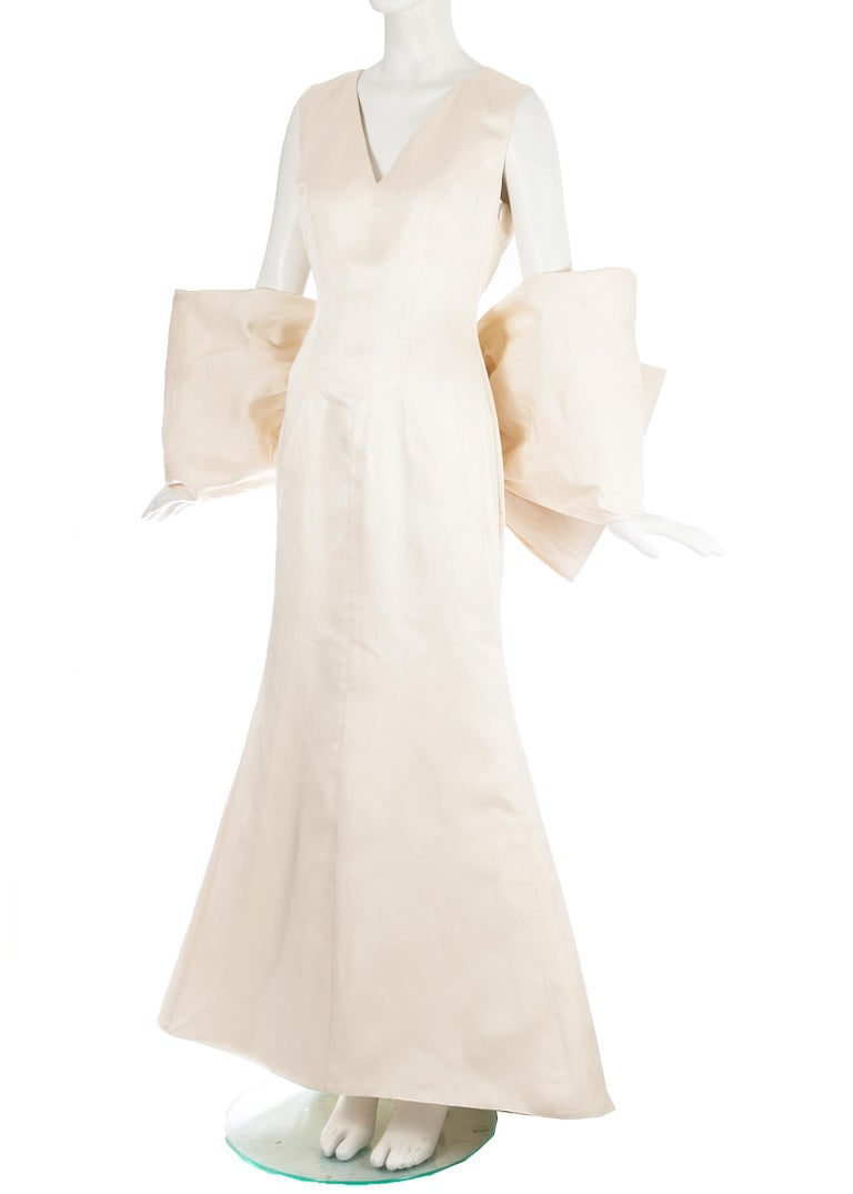 Women's Dolce & Gabbana ivory silk fishtail wedding dress with large bow, c. 1990s For Sale