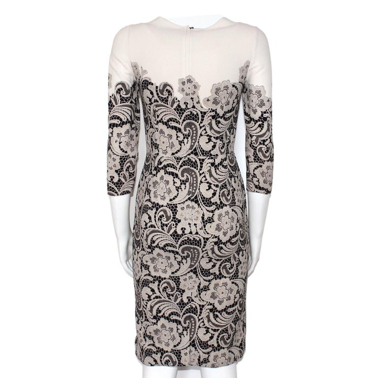 Iconic & chic dress by Dolce & Gabbana Silk Cream, beige and black colors Lace printed 3/4 sleeve Total lenght (shoulder/hem) cm 94 (37 inches) Shoulder length cm 34 (13,4 inches) Worldwide express shipping included in the price !