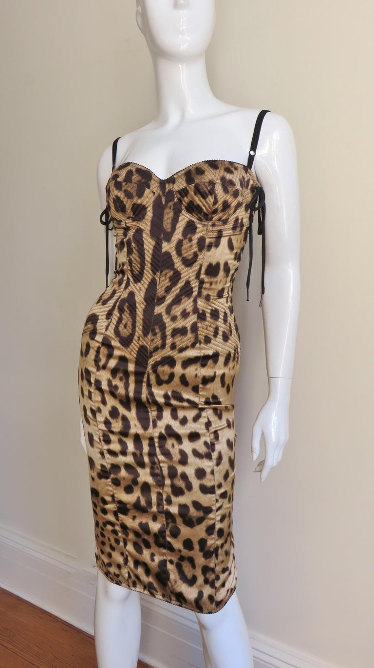 A beautiful silk leopard print dress from Dolce & Gabbana.  The bra style bodice has adjustable straps, functional side lacing from underarm through hips plus rows of top stitching around the cups and flatteringly on angles from the waist through to