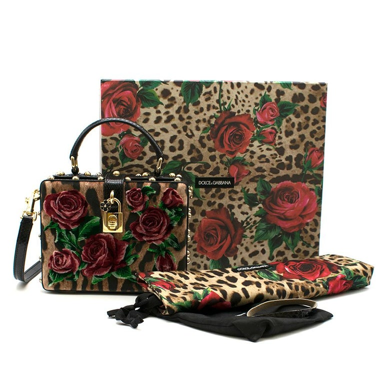 Dolce & Gabbana Leopard-Print Floral Velvet Box Bag  - Velvet leopard and rose detail - Lined in black snakeskin leather detail - Gold studs and hardware - Gold lock at buckle - Props open at an angle - Pockets in good condition - Convertible long