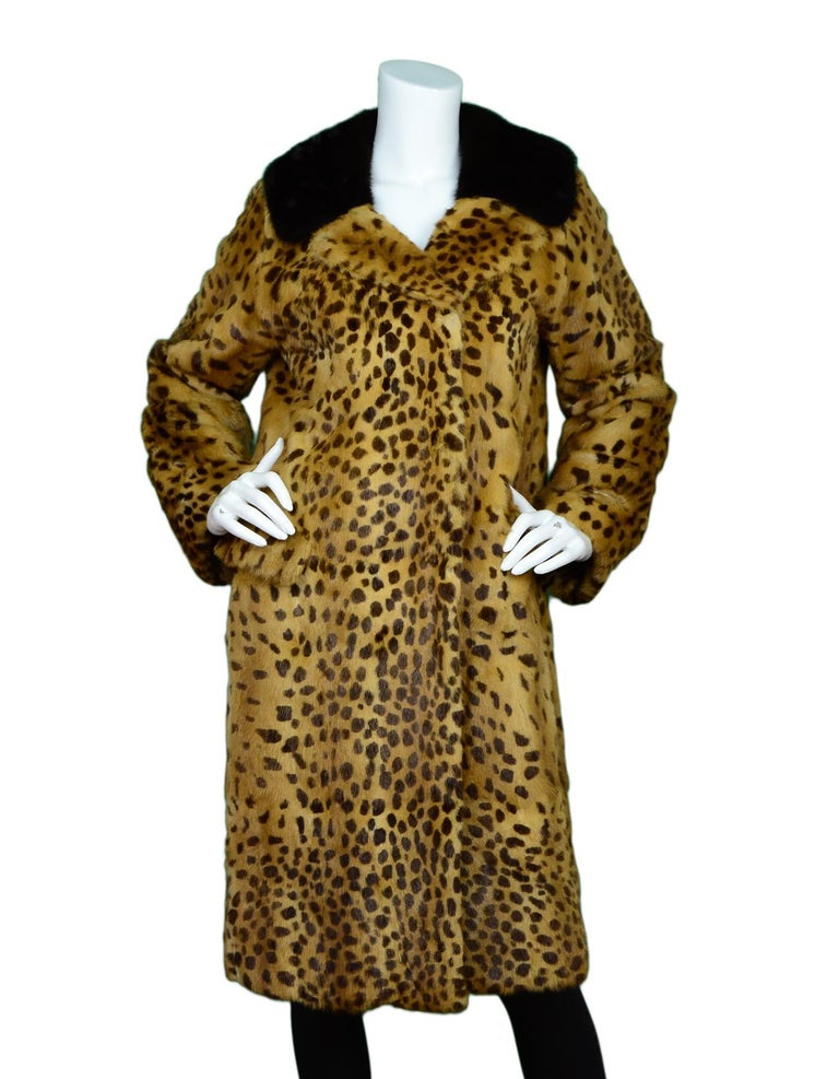 Dolce & Gabbana Leopard Print Fox Fur Coat Sz L  Color: Black, brown Materials: Fox fur (no composition tag) Lining: Black logo textile Opening/Closure: Hook eye closure Overall Condition: Excellent pre-owned condition with exception of no