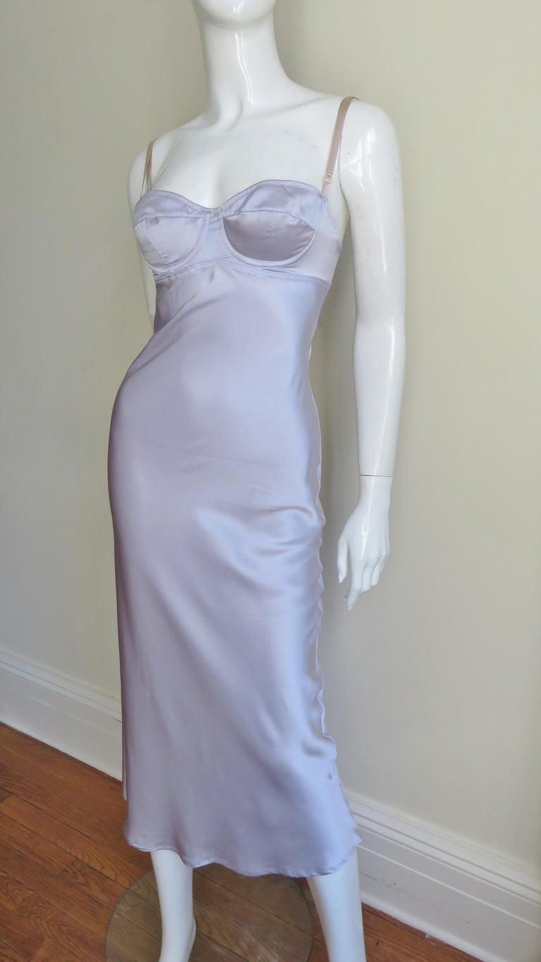 A gorgeous lilac silk dress from Dolce & Gabbana.  It is lingerie inspired with a boned bra style top and adjustable nude straps.  The dress skims the body subtly flaring towards the hem.  It has a hook and eye closure at the top back of the dress