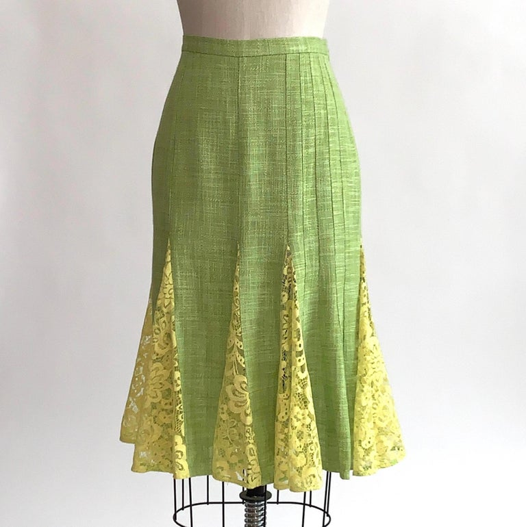 Dolce and Gabbana lime green fit and flare pencil skirt with yellow lace godet panels at bottom. Vertical seam detail at one side. Back zip and hook and eye.  100% viscose (linen-look.) Unlined.  Made in Italy.  Size label has been removed, seems to