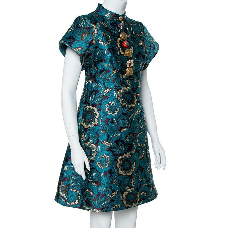 Dolce & Gabbana's mini dress reflects traditional Chinese cheongsam dresses. It's cut from plush jacquard woven with metallic green flowers and has sharp, structured sleeves. Match a pair of earrings to the sparkling row of embossed coins, crystal,