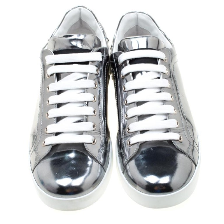 Lend a luxurious appeal to your casuals with these sneakers from Dolce & Gabbana. Crafted from metallic silver mirror leather, they are decorated with laced vamps and platforms with logo detail on the counters. They are the perfect choice when you