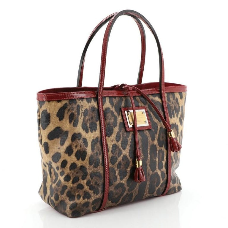 Dolce & Gabbana Miss Escape Open Tote Printed Coated Canvas Medium   Condition: Very good. Loss of shape on exterior and handles, light scuffs on base, slight cracking on handle base wax edges. Minor wear in interior, scratches on