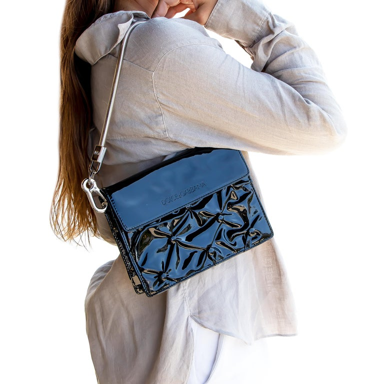 Dolce & Gabbana Miss Jolie shoulder bag silver-tone hardware, single chain-link shoulder strap, embossed logo at front, mauve satin lining, single zip pocket at the interior wall and snap closure at the front flap. Brand: Dolce & Gabbana Outside: