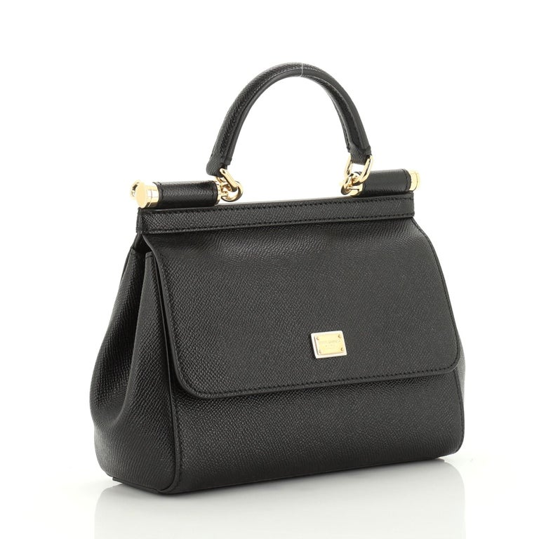 This Dolce & Gabbana Miss Sicily Handbag Leather Small, crafted in black leather, features a leather top handle, and gold-tone hardware. Its framed top flap with magnetic snap closure opens to an animal print fabric interior with zip and slip