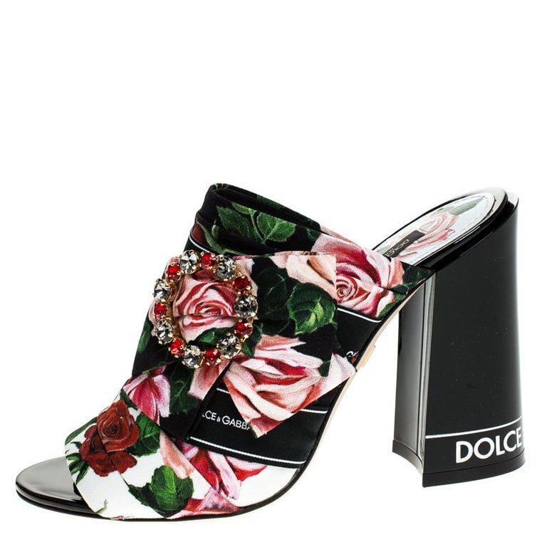 Bold, beautiful and breathtaking, these Dolce & Gabbana mules are made to enchant! They have been crafted from Charmeuse printed fabric and flaunt peep-toes and bejeweled buckles on the uppers. Comfortable leather-lined insoles and 10.5 cm block