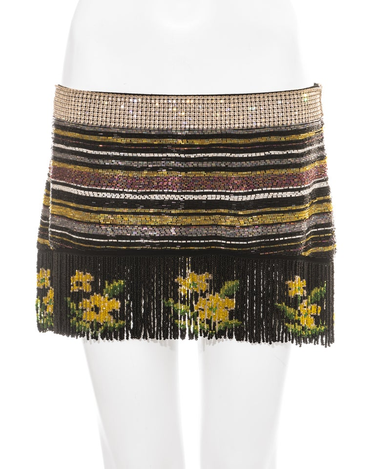 Dolce & Gabbana multicoloured beaded mini skirt with rhinestone waistband, striped beaded pattern and floral hanging fringed hem.   Spring-Summer 2000