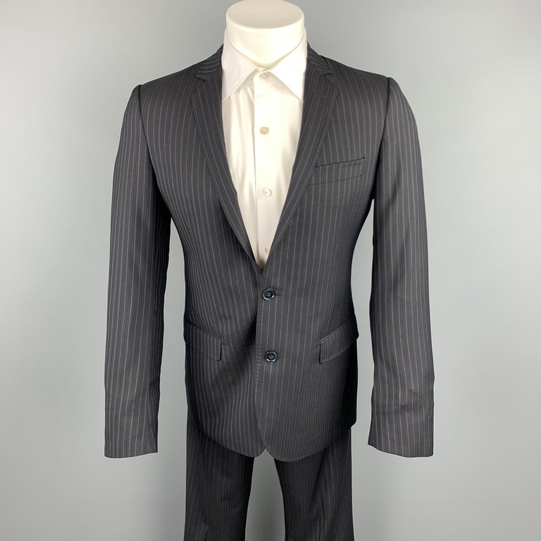 DOLCE & GABBANA suit comes in a black stripe wool / silk and includes a single breasted, single button sport coat with a notch lapel and matching flat front trousers. Made in Italy.  Excellent Pre-Owned Condition. Marked: IT