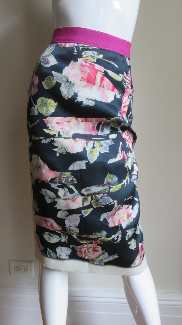 A fabulous silk skirt from Dolce and Gabbana in black and pinks.  It is pencil style with a 2
