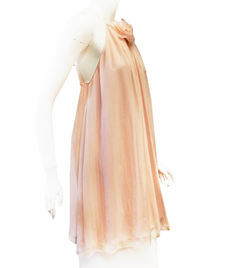 Dolce & Gabbana pink silk chiffon Baby Doll style dress with flower ornament on neckline.  Dress is gathered from the neckline to the hem in a flowy and soft cascade of silk chiffon. It ties at the back and adapts to your measurements.  Scarf can be