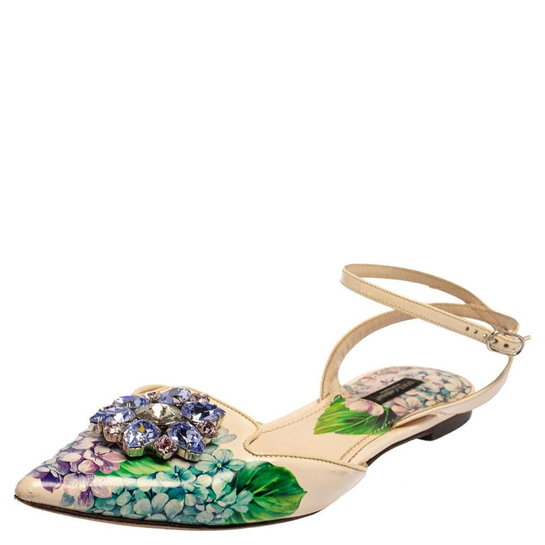 You'll truly fall in love with these flats from Dolce & Gabbana as they are stylish and modern! They flaunt a multicolored floral printed patent leather exterior and vamps decorated with exquisite crystal embellishments. These ankle strap flats are