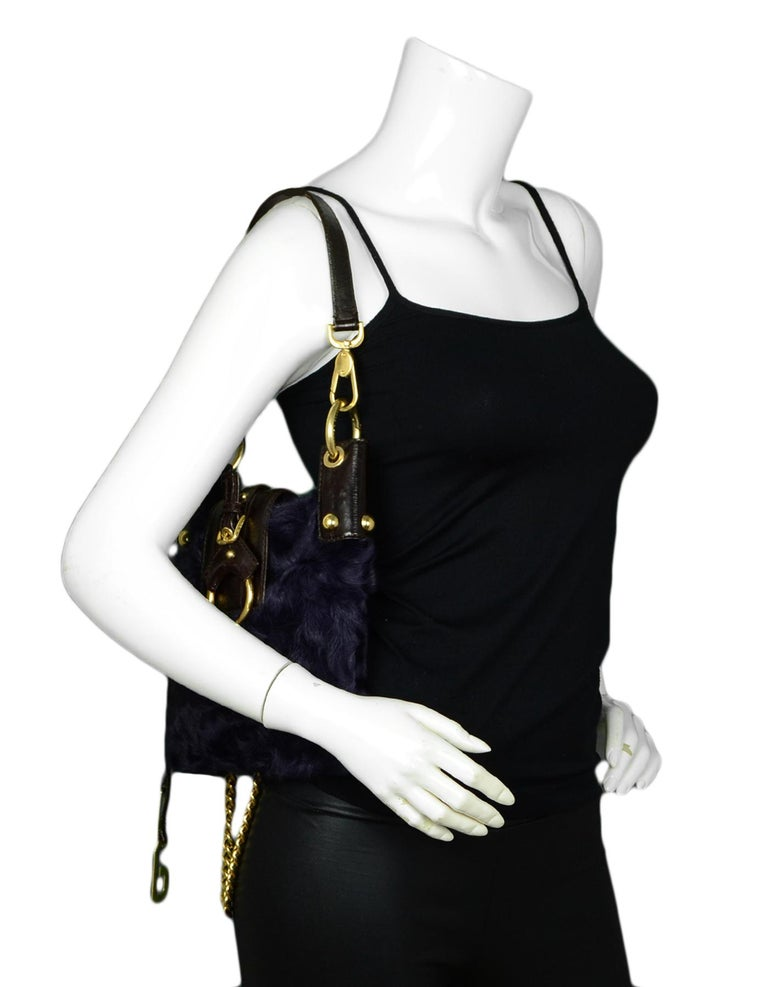 Dolce & Gabbana Purple Fur Bag with Chain Strap   Made In: Italy Color: Purple Hardware: Goldtone Materials: Fur, Leather Lining: Dolce & Gabbana text fine textile Closure/Opening: Open top with snap tab Exterior Pockets: None Interior Pockets: One