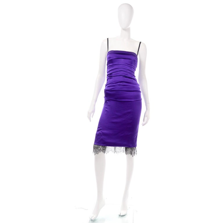 This is a figure-hugging bodycon dress by Dolce & Gabbana in a vibrant purple silk. The dress has the signature Dolce & Gabbana  built-in corset style top and bustier. The black straps are adjustable and connected to the built-in bra. The dress hits