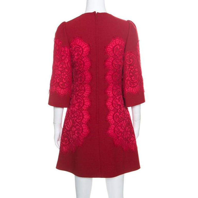This gorgeous dress from Dolce and Gabbana is here to impress you with its fabulous design and style! The red creation is made of a blend of fabrics and features a fit and flare silhouette. It flaunts a floral lace applique detailing that looks