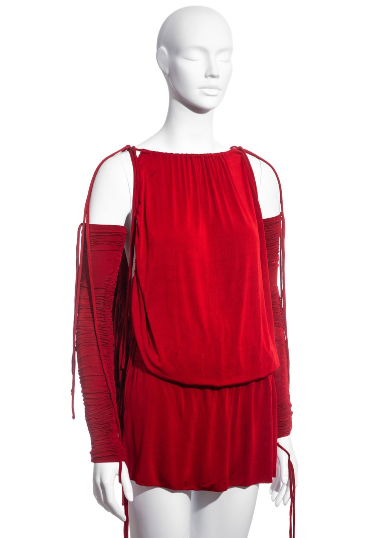 ▪ Dolce & Gabbana red evening mini dress ▪ 91% Rayon, 9% Lycra  ▪ Multiple drawstring fastenings  ▪ Leg slits ▪ Detached ruched sleeves  ▪ IT 38 - FR 34 - UK 6 - US 2 ▪ Spring-Summer 2003