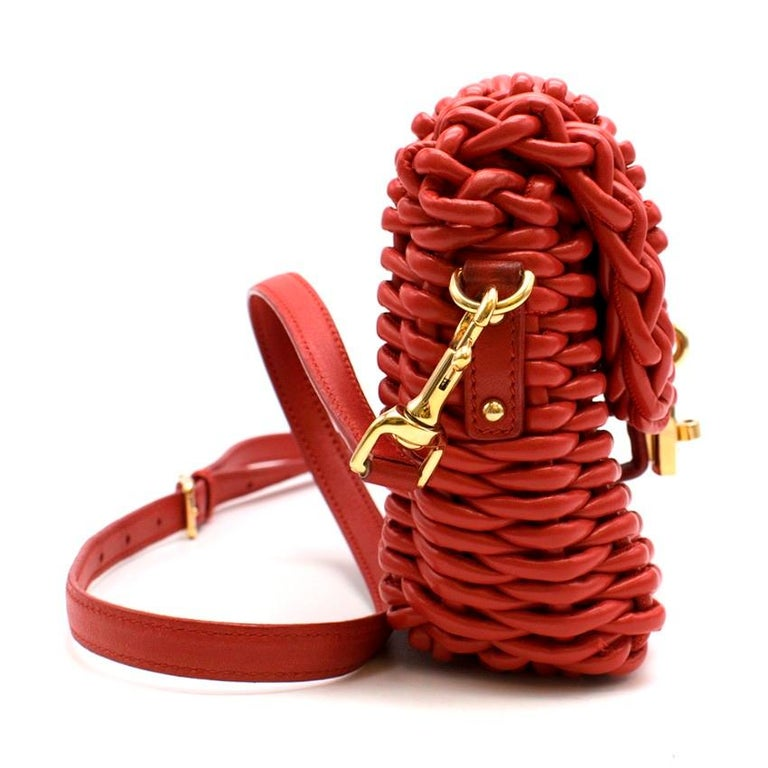 Dolce & Gabbana Red Woven Leather Bag  - Red woven basket style  - Gold-tone padlock with twist lock on the front  - Red leather details and strap  - Gold-tone hardwear  - Leopard lining with inside zip pocket   Materials - Leather - Gold-tone metal