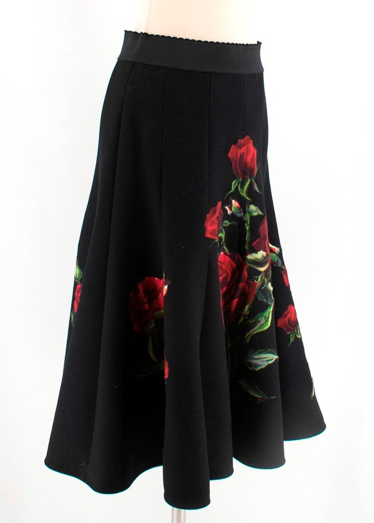 Dolce & Gabbana Black Wool Midi Skirt with Hand Stitched Rose Print. Black Waistband with hidden side zip.  - Pleated Skirt  - Silk Slip Skirt lining   -90% Virgin Wool -10% Viscose  Lining - 88% Silk - 8% Cotton - 4% Elastane - 2% Nylon  Care