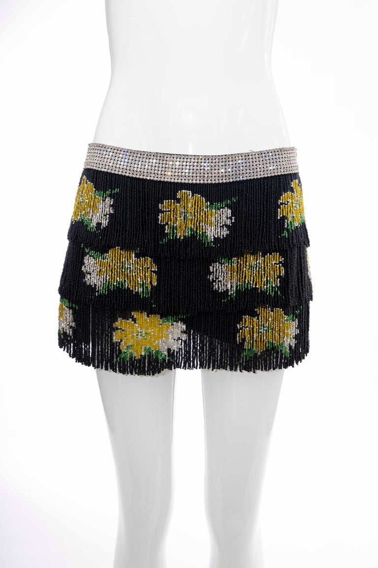 Dolce Gabbana, Runway Spring-Summer 2000, black silk mini skirt with diamanté waistband, three tiered black beaded fringe, zip closure at side and fully lined in silk.  IT. 38, US. 2  Waist: 29, Hip: 34, Length: 11  Fabric: 100% Silk; Lining 100%