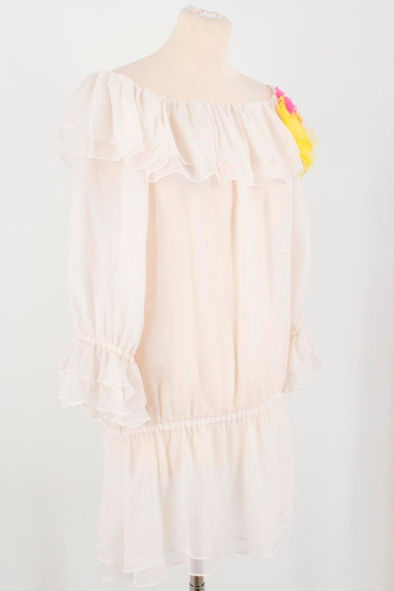 Dolce & Gabbana silk ruffle dress  Featuring: -3/4 length sleeves -ruffled cuffs and hem  -pleats detail -semi-sheer material -slips on -elastic hips -flower embroidery Care label is missing  Condition: 9/10 Very minor pulls to the material, due to