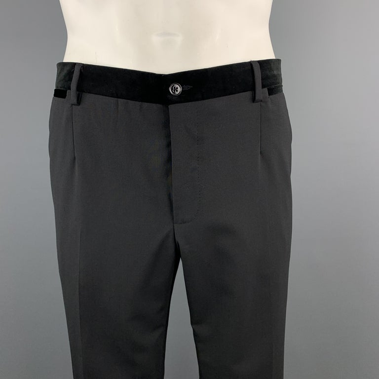 DOLCE & GABBANA dress pants come in black wool with a velvet waistband, flat front, and tuxedo side stripe. Made in Italy.  Excellent Pre-Owned Condition. Marked: IT 54  Measurements:  Waist: 38 in. Rise: 10 in. Inseam: 31 in.