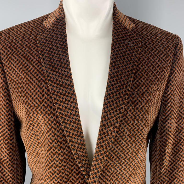 DOLCE & GABBANA sport coat comes in copper brown and black houndstooth velvet with a notch lapel, single breasted, single button front, and gold tone black enamel crest buttons. Made in Italy.  Excellent Pre-Owned Condition. Marked: IT