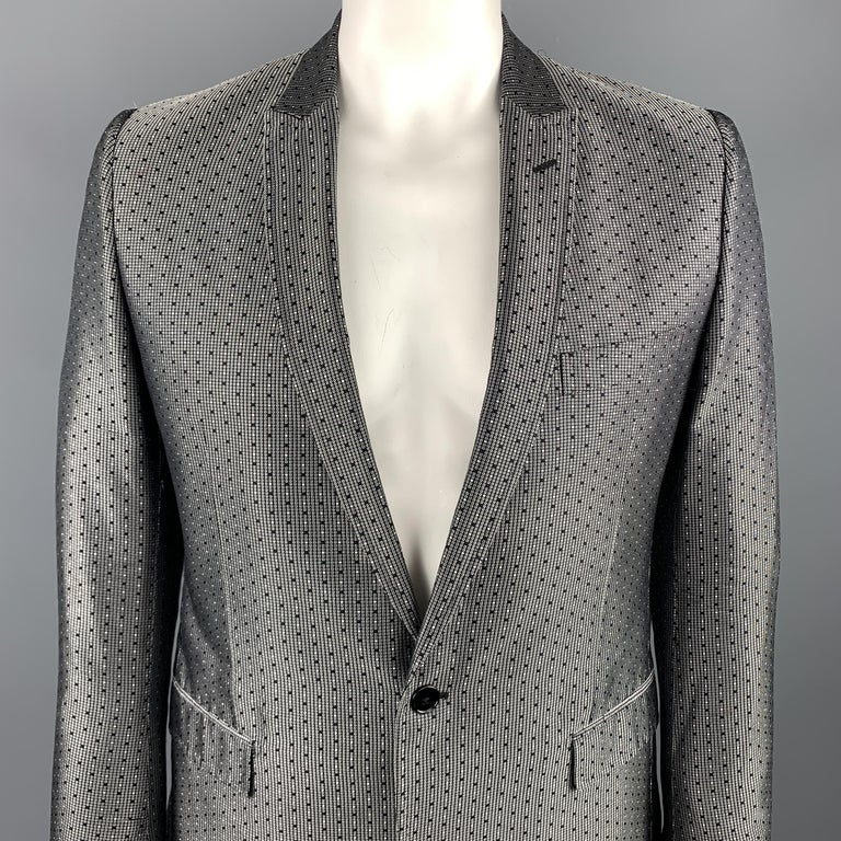 DOLCE & GABBANA sport coat comes in a black and silver jacquard silk featuring a peak lapel style, flap pockets, and a single button closure. Made in Italy.  Excellent Pre-Owned Condition. Marked: IT 52  Measurements:  Shoulder: 17.5 in.  Chest: 42