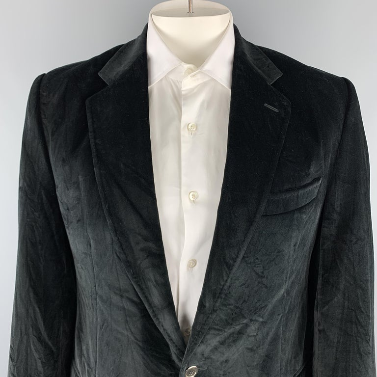 DOLCE & GABBANA sport coat comes in a black cotton velvet material, featuring a notch lapel, two buttons at closure, slit and flap pockets, single breasted, buttoned cuffs, and a double vent at back. Wear throughout from storage. Made in