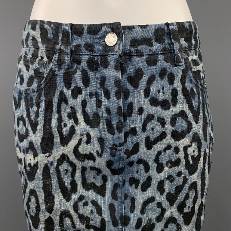 DOLCE & GABBANA pencil skirt comes in washed blue and black leopard print denim with distressing throughout, metal embossed back plaque, and pencil skirt silhouette. Made in Italy.  New with Tags.  Marked: IT 42 Original Retail Price: