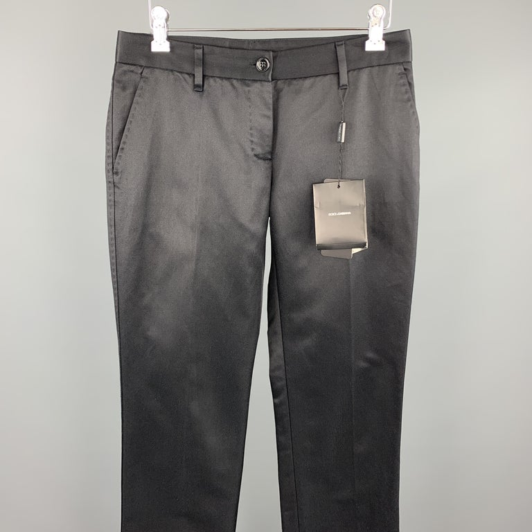 DOLCE & GABBANA dress pants black cotton / silk featuring a flat front and a zip fly closure. Made in Italy.  New With Tags. Marked: IT 38  Measurements:  Waist: 29 in.  Rise: 6.5 in.  Inseam: 35 in.