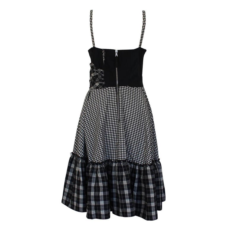 Boho dress by Dolce & Gabbana Cotton (33%) Virgin wool (30%) Viscose (15%) Polyamide (12%) Elasthane Black and white color Rigid corset Total length cm 98 (38.5 inches) Worldwide express shipping included in the price !