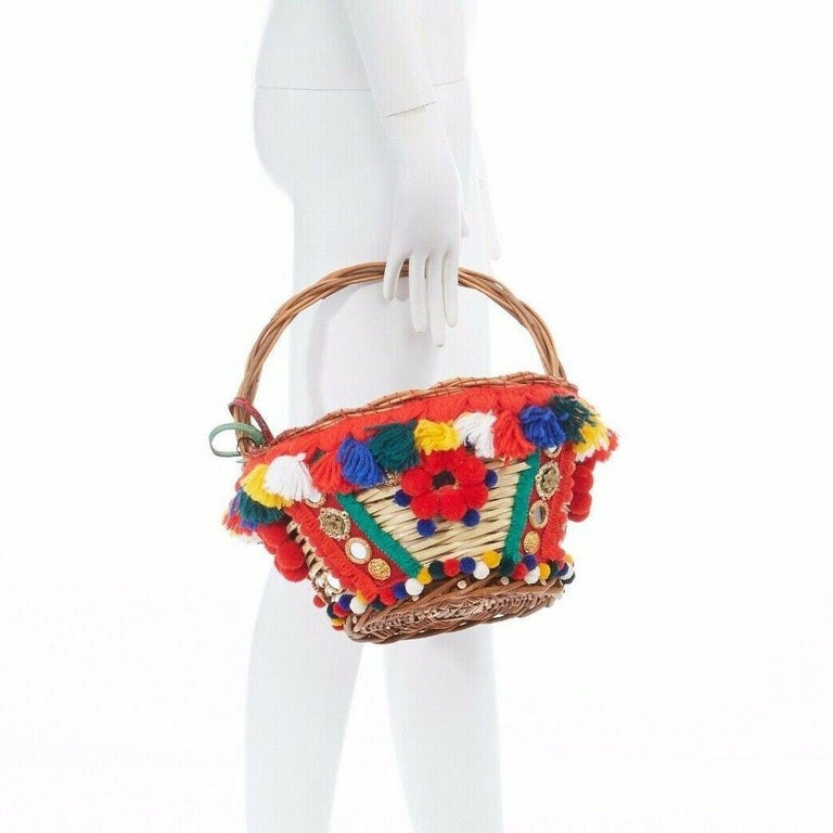 DOLCE GABBANA SS16 red pom pom embellished wicker basket pouch iphone case bag  DOLCE &GABBANA FROM THE SPRING SUMMER 2016 COLLECTIONTrimmed with bright tassels, pompoms and mirrors, Dolce & Gabbana's woven wicker basket is an eye-catching accessory