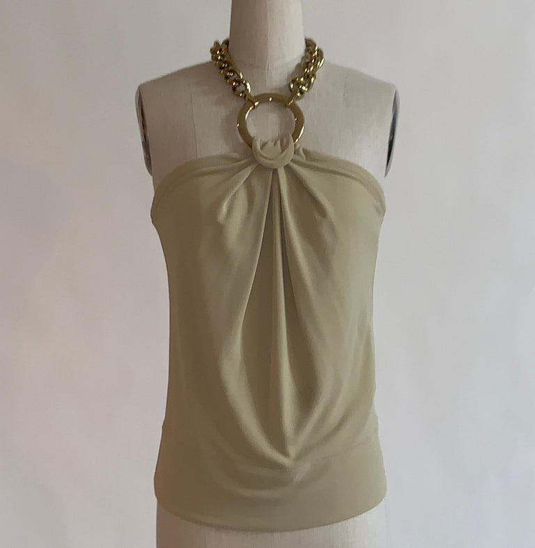 Dolce & Gabbana light tan jersey halter tank with a thick gold chain necklace style closure attached to gold hoop.  80% acetate, 20% nylon.  Made in Italy.  Size IT 40. Bust 31