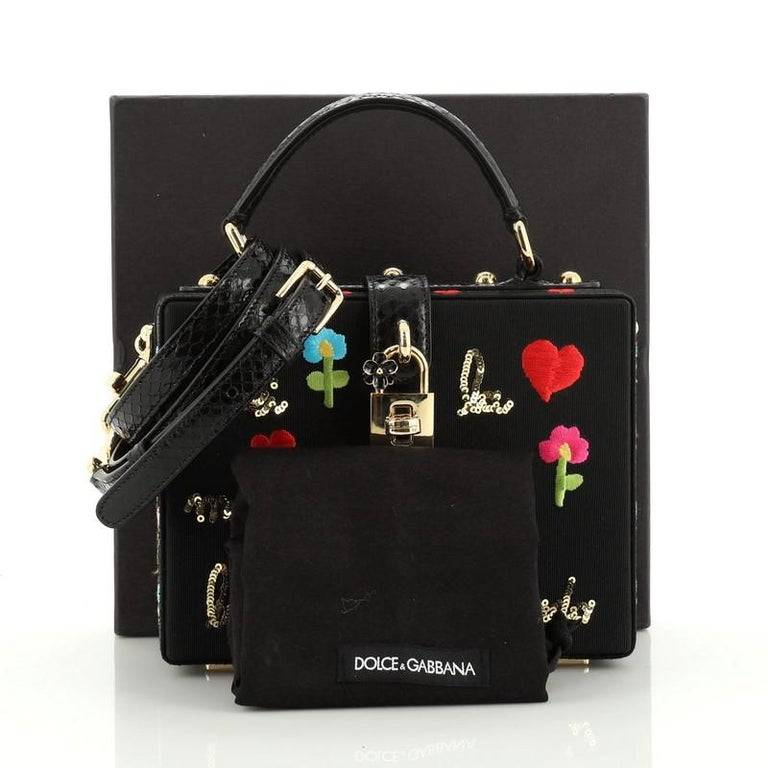 This Dolce & Gabbana Treasure Box Bag Embroidered Grosgrain Small, crafted in black grosgrain, features a top handle, multicolor embroidery and gold-tone hardware. Its turn-lock closure opens to a brown microfiber interior with slip pocket.