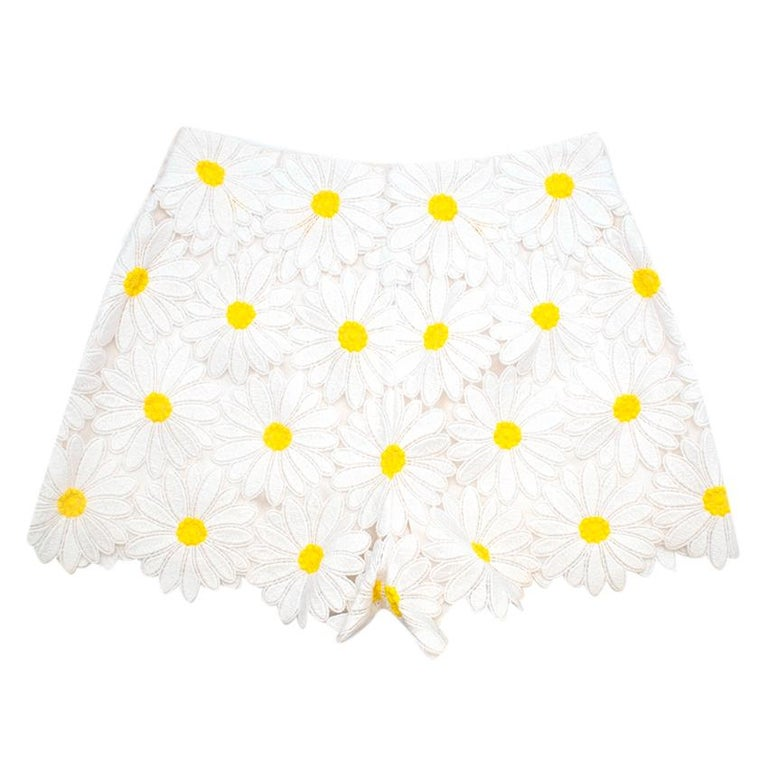 Dolce & Gabbana Yellow Daisy Applique Short with Silk lining.   - Hidden side zip with double snap fastening  - High-waisted    Materials  - 68% Cotton - 29% Polyester - 3% Nylon  Lining  - 94% Silk  - 6& Elastane  Care  - Dry Clean Only   - Made in