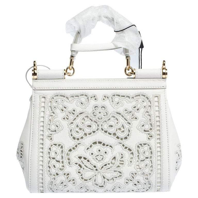 Dolce & Gabbana's Miss Sicily bag is a coveted design defined by a top handle and a signature shape. Crafted from leather, the bag features laser cuts all over and a spacious interior to hold your essentials.  Includes: Original Dustbag, Shoulder