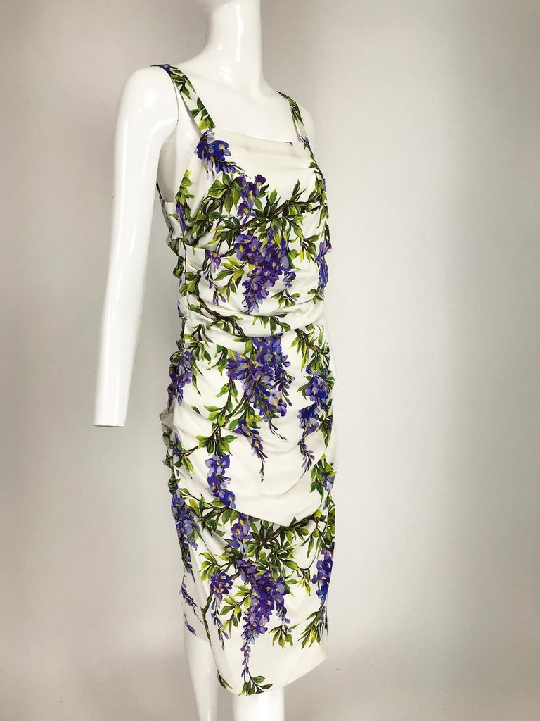 Dolce & Gabbana wisteria-print stretch silk blend crepe dress. Formfitting dress has a square low neckline at front and back, sleeveless with wide shoulder straps. The ruched side seams create a draped bodice and skirt, nips at the natural waist.
