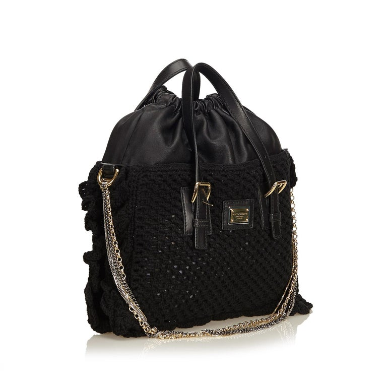 This tote features a mesh and crochet body, dual flat handles, and a drawstring closure. It carries as AB condition rating.  Inclusions:  This item does not come with inclusions.  Dimensions: Length: 22.00 cm Width: 33.00 cm Depth: 6.00 cm Hand