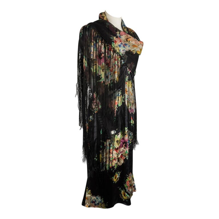Guaranteed authentic Dolce&Gabbana floral profusion print black dress with matching shawl.    Iconic fit with subtle stitch detail at the bust, the sides, the hip area and below the hip in the rear. These details accentuate the fit of this dress and