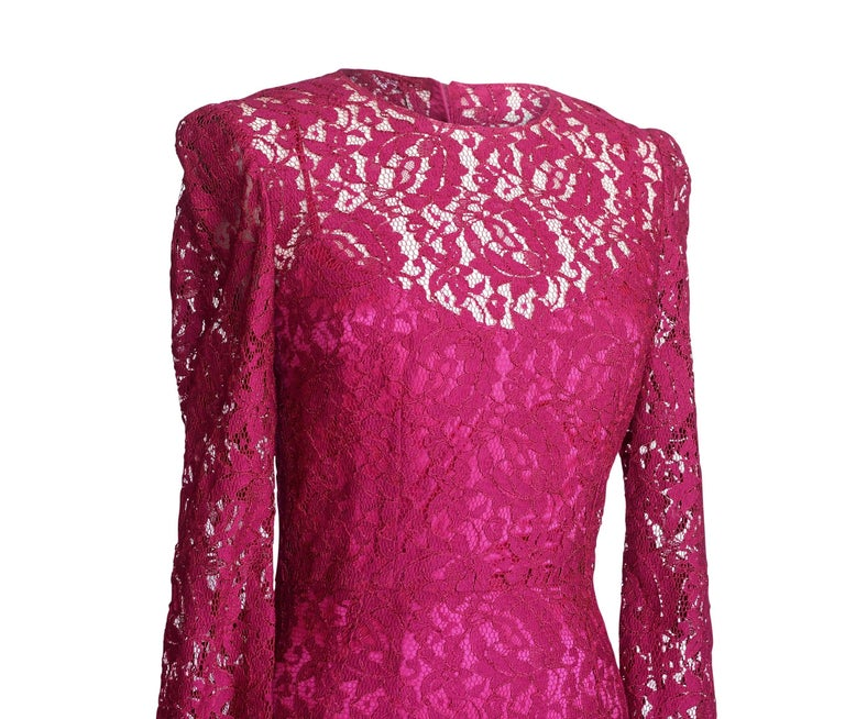 Guaranteed authentic Dolce&Gabbana jewel toned raspberry pink lace dress.   Beautifully cut shaped long sleeved rich lace. Rear hidden zip. Comes with separate raspberry silk slip. Fabric is rayon and nylon. NEW or NEVER WORN. final sale       SIZE