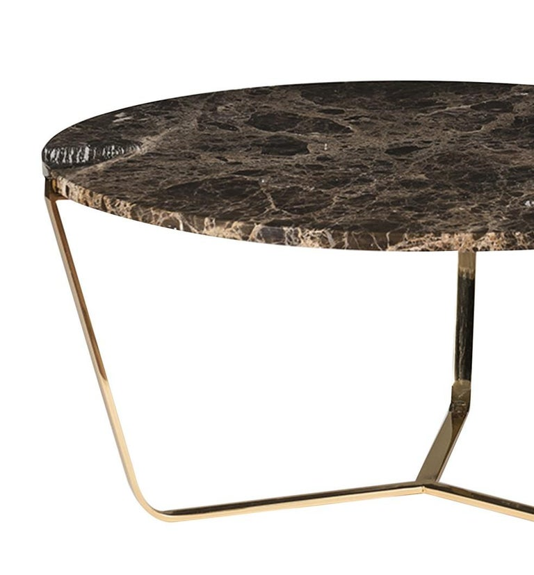 Elegant and timeless, this tall coffee table is part of the Dolomiti collection and boasts a stunning top in Emperador Dark marble, 2cm thick and with a radius edge. This unique piece is supported by a steel structure in which the three slightly