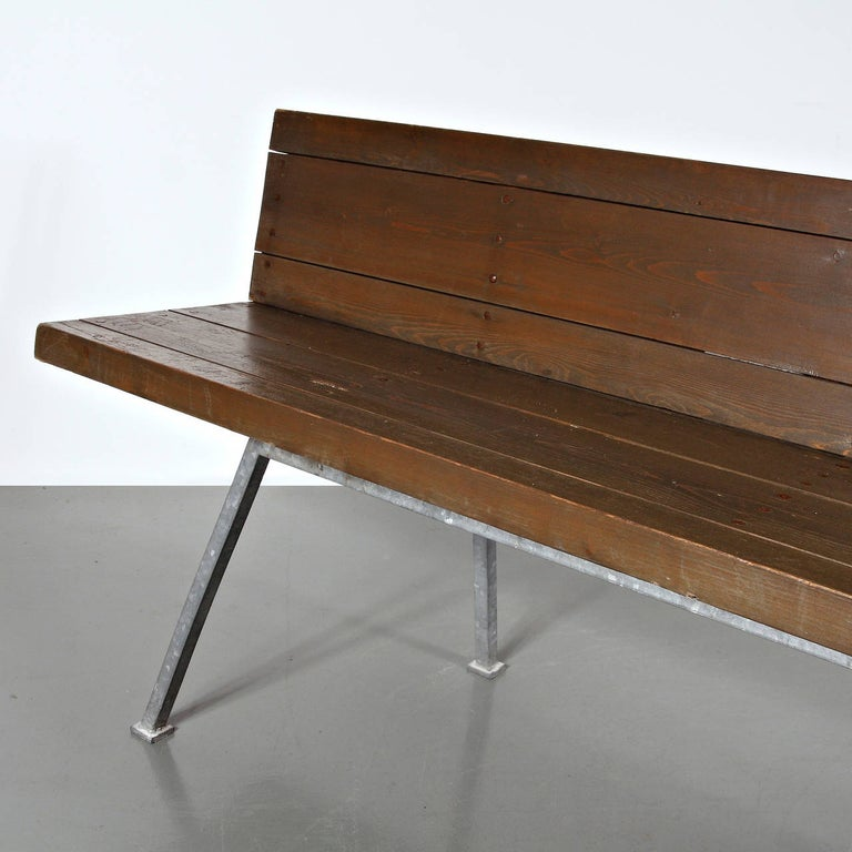 Bench designed by Dom Hans van der Laan for the Abbey Church of St. Benedictusberg, Vaals in the Netherlands in 1967. Manufactured in the Netherlands in 1967. Galvanized base and structure, wood seat and backrest with copper nails.  In good
