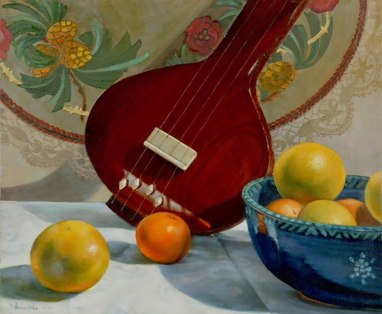 Original oil painting on linen canvas: a still life with a tambura, ( musical instrument from India), a colorful fruit bowl, oranges and grapefruits, a tapestry and a lace doily. The style is realistic, executed with many glazes. This painting is